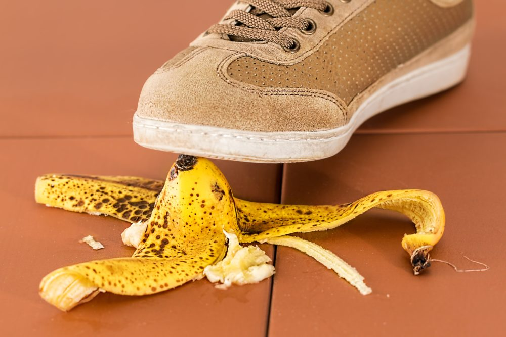 person stepping on banana