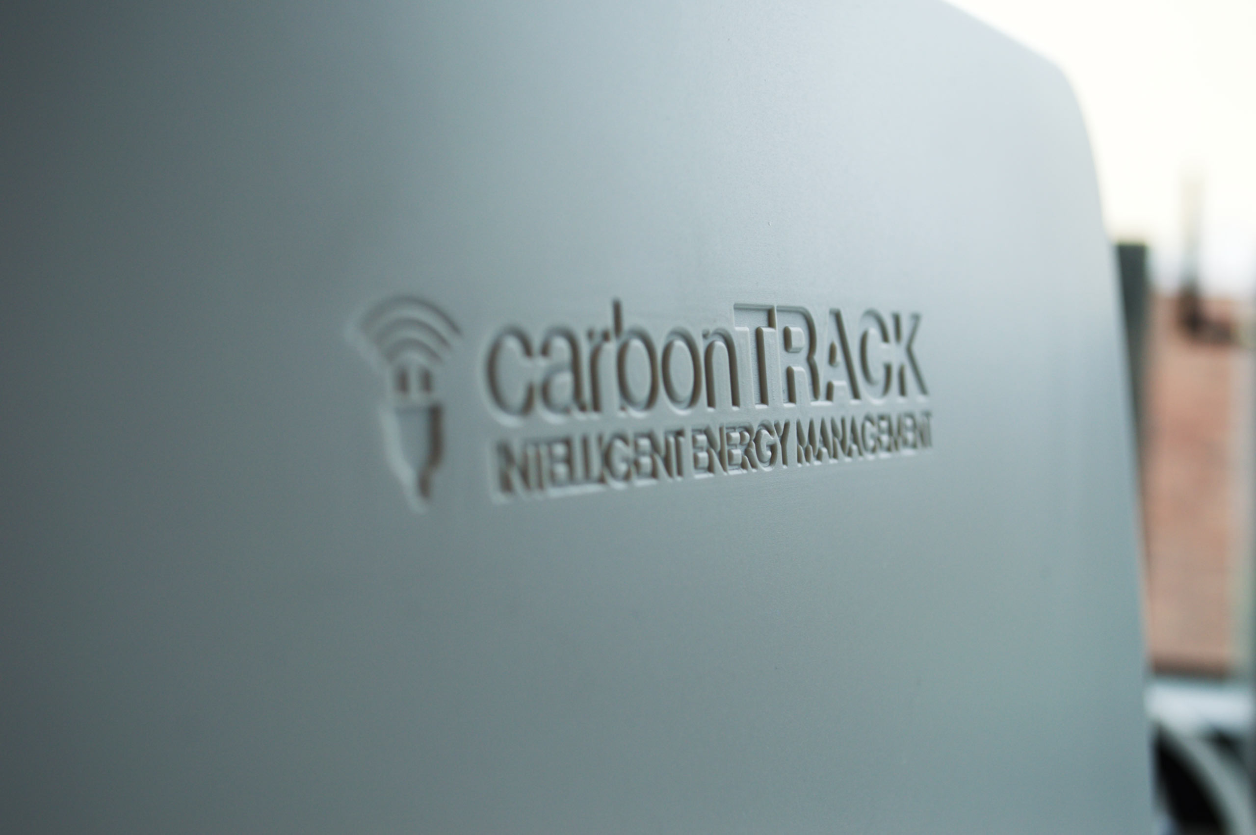 The smooth, grey, weatherproof enclosure of the carbonTRACK Smart Hub shown close up.